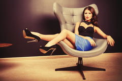 Lying on chair Royalty Free Stock Images