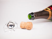 Lying champagne bottle with cork. And closure Royalty Free Stock Photo