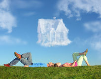 Lying Couple On Grass And Dream House Collage Stock Images