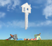 Lying Couple On Grass And Dream House Key Collage Royalty Free Stock Photos