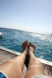 Lying on deck of yacht Royalty Free Stock Images