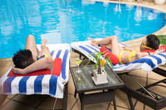 Lying on deckchairs Royalty Free Stock Images