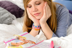Lying depressed girl with broken heart Stock Image