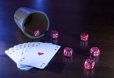 Lying Dice Cup With Dices And Cards Royalty Free Stock Images