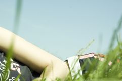 Lying down in grass Stock Photo