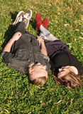 Lying down on grass together Stock Photography