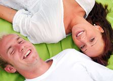 Lying down upside down Stock Image