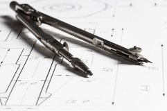 Lying drawing compasses Stock Photo