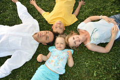 Lying family. With children on grass Stock Image