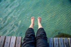 Lying feet to the sea Royalty Free Stock Photo