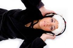 Lying Female Listening Music On Headphone Royalty Free Stock Photo