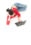 Lying on the floor teenage girl using laptop Royalty Free Stock Photos