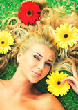 Lying in flowers Stock Photos