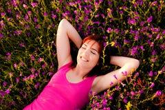 Lying on flowers Stock Image