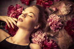Lying in flowers Royalty Free Stock Image