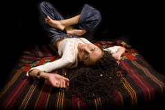 The lying girl. The lying beautiful girl with the African plaits Royalty Free Stock Image