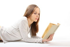 Lying girl with a book Royalty Free Stock Images