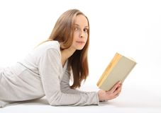 Lying girl with a book Stock Image