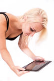 Lying Girl Holding Tablet PC Royalty Free Stock Photo