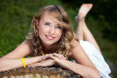 Lying girl. Relaxing beautiful girl in the park royalty free stock photos