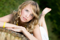 Lying girl. Relaxing beautiful girl in the park stock images