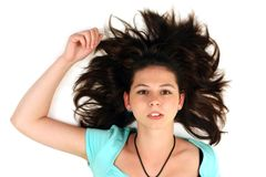 Lying girl with spread hair Stock Image