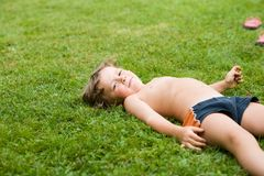 Lying on the grass Royalty Free Stock Photography