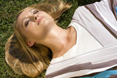 Lying in the grass Stock Photos