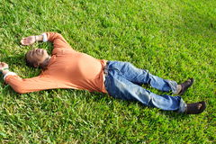 Lying on Grass Stock Photos