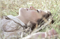 Lying in the grass Royalty Free Stock Images