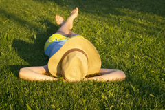 Lying in the grass Royalty Free Stock Photography