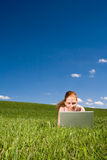 Lying in grass with internet royalty free stock photography