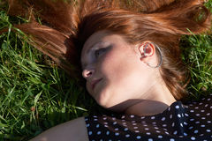 Lying on the grass Stock Photography