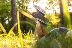 Lying on a grass in sneakers Stock Images