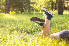 Lying on a grass in sneakers Royalty Free Stock Photography