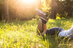 Lying on a grass in sneakers Stock Photo