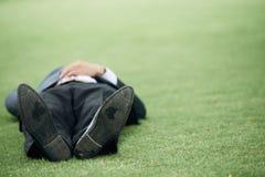 Lying on grass royalty free stock photos