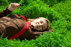 Lying in green grass Royalty Free Stock Image