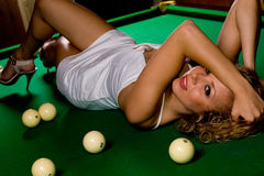 Lying on green snooker table Royalty Free Stock Images