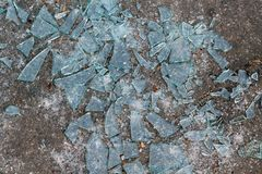 Lying on the ground a lot of sharp fragments of broken glass. royalty free stock photos