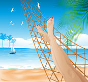 Lying in the hammock on the beach Stock Photo