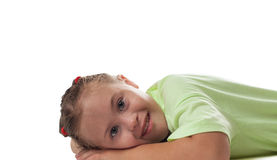 Lying horizontally girl photographed close up. On a white background Stock Images