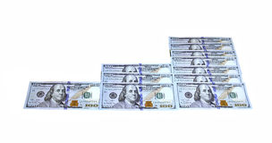 Lying hundred-dollar bills of the new sample isolated. On white background Stock Image
