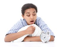 Lying lady looking with amazement at alarm clock Royalty Free Stock Image