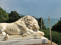 Lying lion near the Vorontsov Palace in Crimea Royalty Free Stock Photo