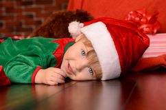 Lying little boy in festive attire indoors Royalty Free Stock Image