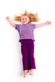 Lying little girl with long hair Stock Photos