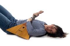 Lying man with balalaika Royalty Free Stock Photos