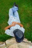 Lying man in cowboy hat Stock Photography