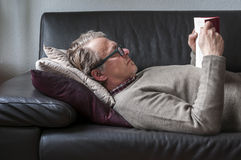 Lying Man reading book Stock Images